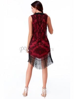 Vestido bordado de pedrería con detalle de flecos de piedras